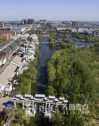 当时南段2.1公里和北段1.8公里的河道未能列入改造计划。(沙王河中段景观)